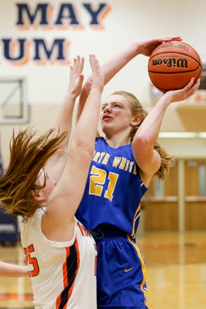 North White's Lynzi Heimlich (21) goes up for a shot against Harrison's Emma Henderson (25) during the third quarter of an IHSAA girls basketball game, Wednesday, Dec. 30, 2020 in West Lafayette.
