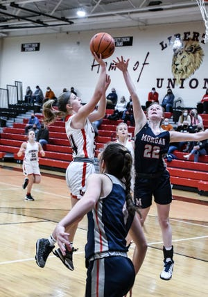 Liberty Union senior Emilee Powers shoots a lay up against Morgan Wednesday night at LUHS.  The Lady Lions defeated Raiders 49-20.