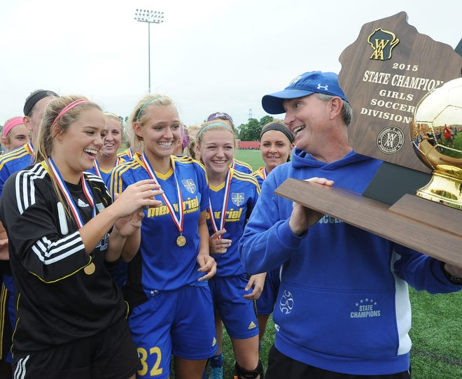 Members of the Catholic Memorial team wait in anticipation as coach John Burke gets ready to hand off the Division 3 championship trophy as they defeated Green Bay Notre Dame 2-1 at Uihlein Soccer Park in Milwaukee Saturday, June 20, 2015.