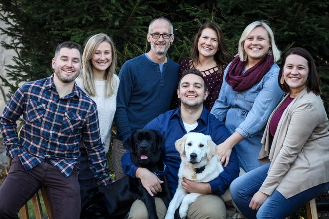 Oak Creek Ald. Chris Guzikowski was recently diagnosed with Huntington's disease. Here the family poses together, from left, Nate Renner, Carley Renner, Chris Guzikowski, Colleen Guzikowski, Lauren Guzikowski, Matt Schutte and Alyssa Guzikowski.