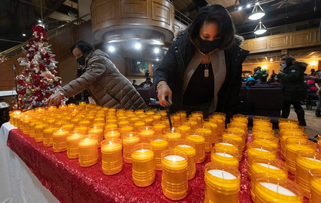 People prepare for a candlelight vigil for 2020 homicide victims Wednesday at El-Bethel Church-God In Christ, 5401 W. Good Hope Road in Milwaukee. The memorial, called Milwaukee Lights a Candle for Change, was to honor the nearly 200 homicide victims in the city of Milwaukee, a record.