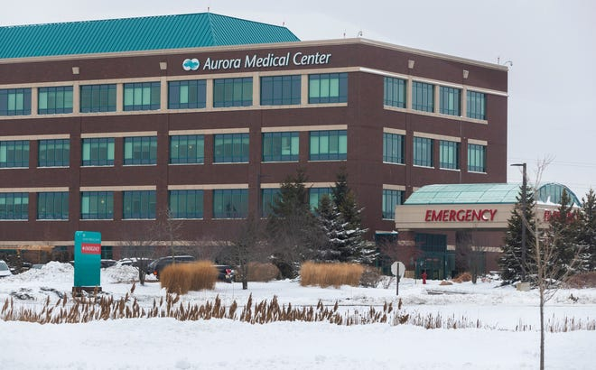 Aurora Medical Center is shown Thursday, Dec. 31, 2020, in Grafton, Wis. Advocate Aurora Health says a now-fired employee intentionally removed 57 vials of the Moderna coronavirus vaccine from a refrigerator last weekend, causing them to become ineffective and be discarded.
