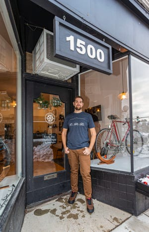 Chris Brannin stands outside his newly opened Tosa Bike Garage at 1500 Underwood Ave. in Wauwatosa. The appointment-based shop features repairs, tune-ups, custom bike builds and a variety of accessories.