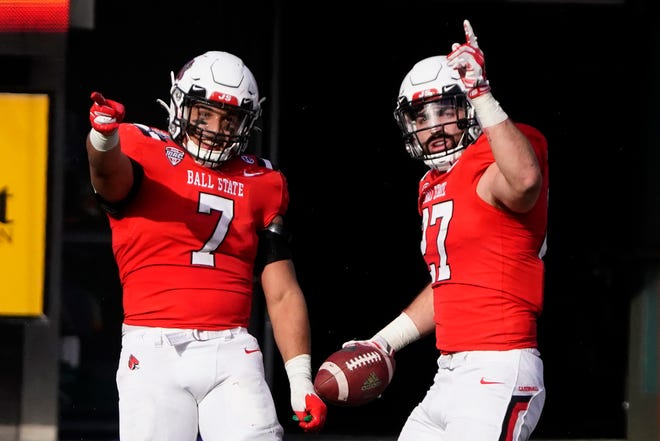 Ball State linebacker Jimmy Daw celebrates with Brandon Martin (7) after intercepting a San Jose State pass during the second half of the Arizona Bowl NCAA college football game Thursday, Dec. 31, 2020, in Tucson, Ariz. Ball State won 34-13. (AP Photo/Rick Scuteri)