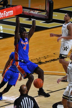 Florida forward Anthony Duruji dunks Wednesday against Vanderbilt during the second half at Memorial Gymnasium in Nashville, Tenn.