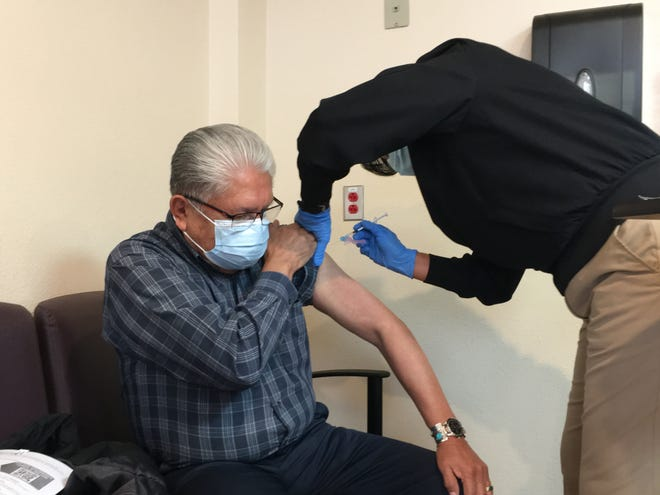 Navajo Nation Council Delegate Edison Wauneka receives the Pfizer-BioNTech COVID-19 vaccine on Dec. 31, 2020 at Gallup Indian Medical Center in Gallup.