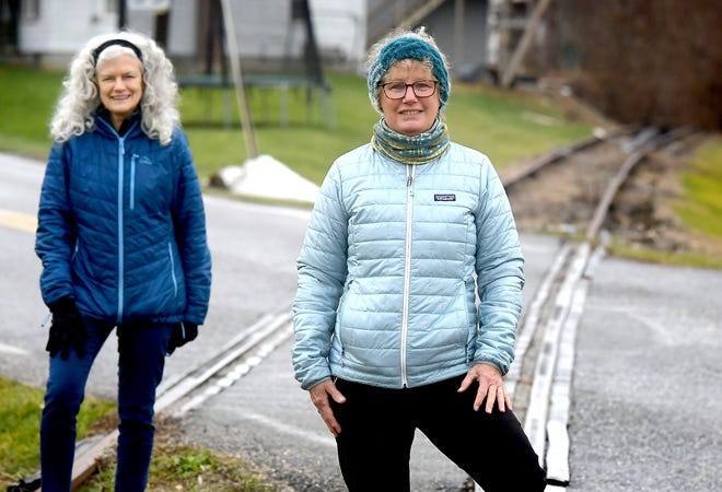 Gwen Loose, executive director of the York County Rail Trail Authority, and Terry Reichard, Hanover Trolley Trail advisory committee member, left, stand along a newly acquired section of track near Menges Mills Thursday, Dec. 31, 2020. Bill Kalina photo