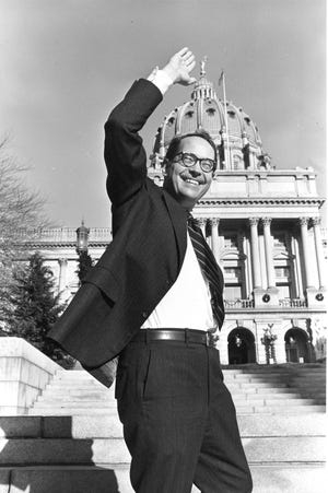 FILE - In this Dec. 13, 1978 file photo, Pennsylvania Governor-elect Dick Thornburgh waves at photographers from the front steps of the Sate Capitol in Harrisburg, Pa.  Thornburgh died Thursday, Dec. 31, 2020 at a retirement community facility outside Pittsburgh, his son David said.  (AP Photo/Paul Vathis, File)