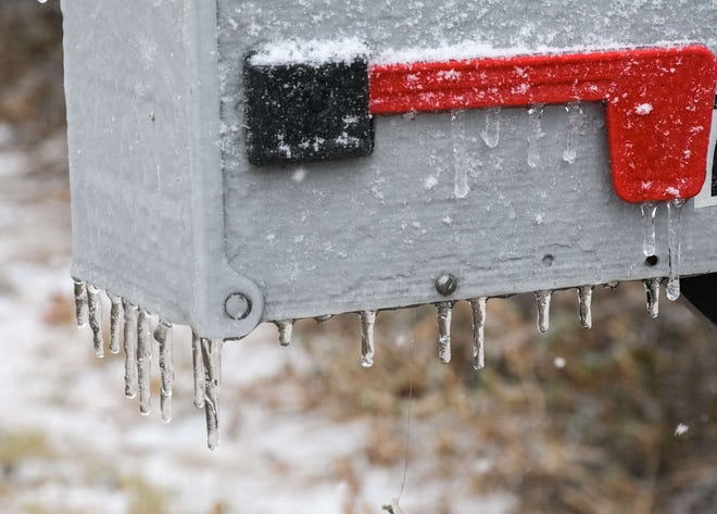 Snow and ice on a mailbox in San Angelo.