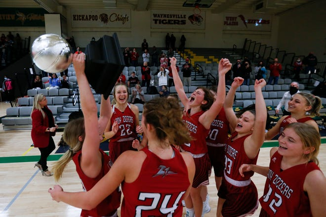 The West Plains Lady Zizzers celebrate after beating the Nixa Lady Eagles in a triple overtime game to win the championship of the White division of the Pink and White Tournament at Parkview High School on Thursday, Dec. 31, 2020.
