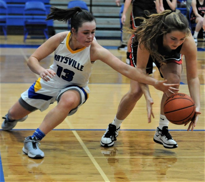 Maysville's Anna Devolld goes for a loose ball against a Tusky Valley player during Wednesday's game. The Panthers won 69-39.