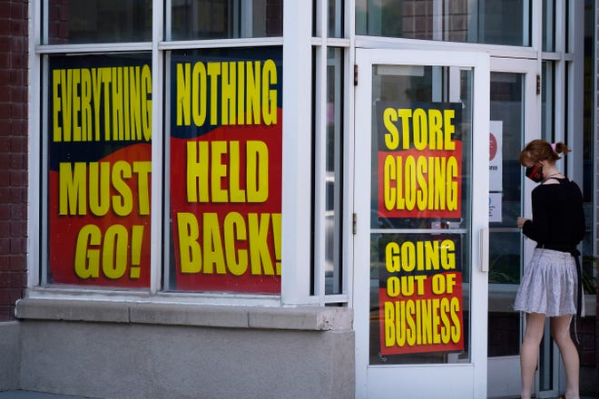 Sale signs adorn a closing Stein Mart store in Salt Lake City in August.