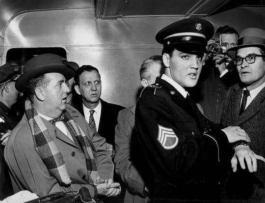 Elvis Presley (right) and Colonel Tom Parker (left) in 1960. Parker died Jan. 21, 1997.