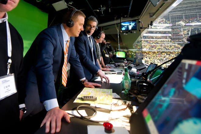 ESPN analyst Kirk Herbstreit will be calling Friday's national semifinal game between Clemson and Ohio State from home after testing positive for COVID0-19.