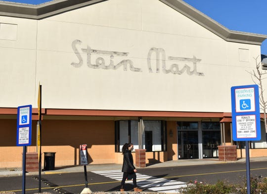 A shopper passes a Stein Mart store that closed recently at Ellisburg Shopping Center in Cherry Hill.