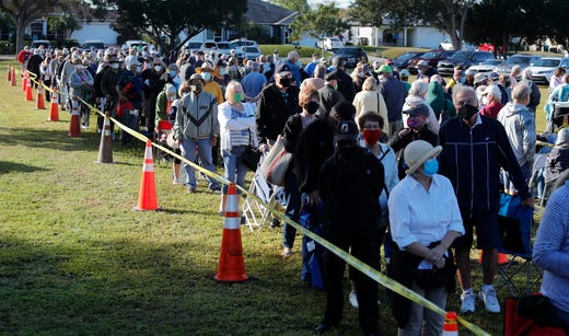 Cape Coral residents wait in line to receive a COVID-19 vaccine on Dec. 30, 2020 during first day of vaccinations in the city at Cultural Park Theater. The Florida Department of Health in Lee County is offering COVID-19 vaccine to high-risk frontline health care workers and those 65 and older.