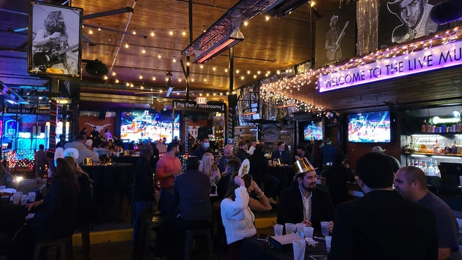 Despite local curfews announced by city officials earlier this week, many celebrated the new year at bars on Sixth Street in downtown Austin.