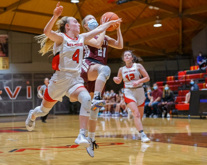 Austin High guard Daphne Johnson drives to the basket as Lake Travis Cavaliers guard Peyton Ferrell defends during the second period at a District 26-6A girls basketball game Dec. 31 at Lake Travis High School. Austin High raced to a 72-32 win to remain unbeaten in district play.