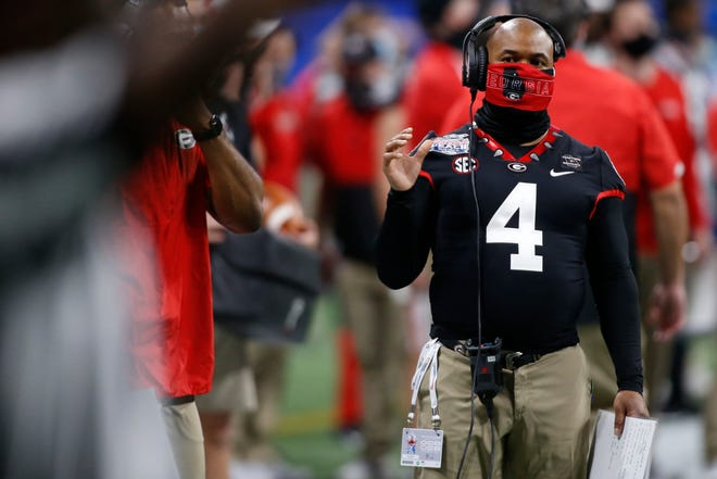 Georgia running backs coach Dell McGee on the sideline during the second half of the Peach Bowl NCAA college football game between Georgia and Cincinnati at Mercedes-Benz Stadium in Atlanta., on Friday, Jan. 1, 2021.  Georgia won 24-21.
