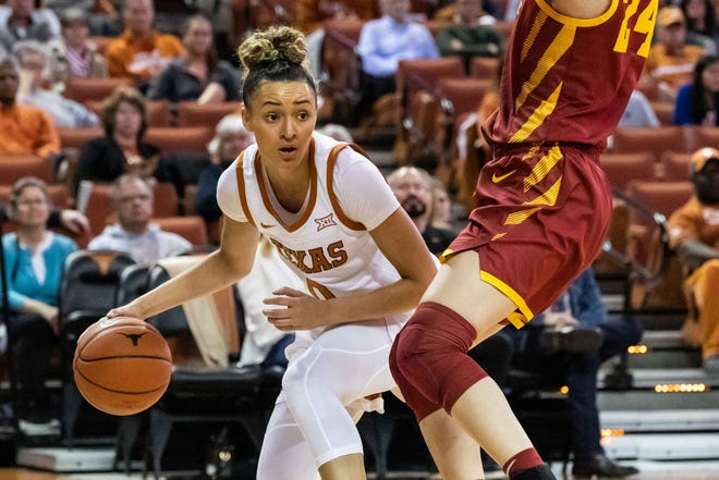 Texas guard Celeste Taylor (0) attempts to drive around Iowa State's Ashley Joens (24) in Austin on Feb. 12, 2020.