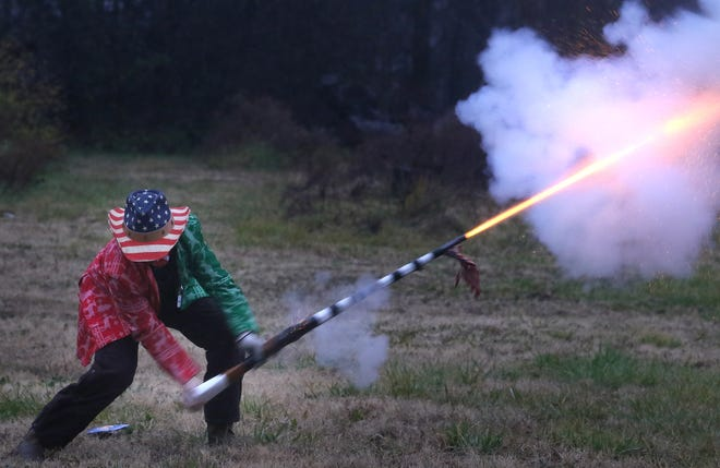 Muskets are fired outside Heafner's Superette in Cherryville early Friday morning, Jan. 1, 2021, where members of the Cherryville Traditional New Years Shooters gathered to ring in the new year.