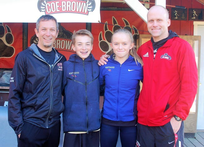Coe-Brown cross country co-coaches Brent Tkaczyk, left, and Tim Cox, right, have been named MileSplit.com National Boys Cross Country Coaches of the Year. They are pictured here in 2017 with their oldest children: Luke Tkaczyk and Addison Cox.