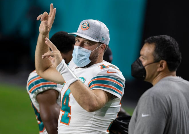 Dolphins quarterback Ryan Fitzpatrick manages to squeeze his famous beard under a mask to comply with NFL protocols.