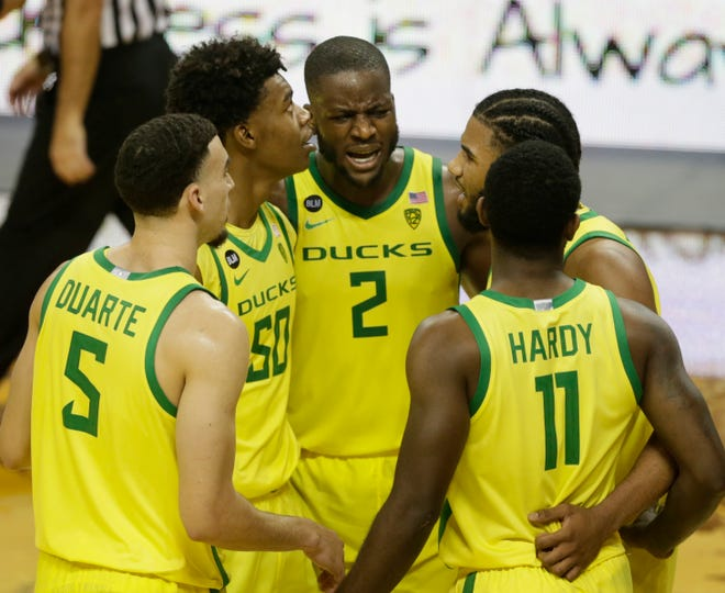 Oregon players come together at mid court during the second half against California.