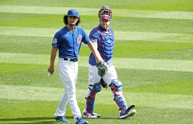 Cubs pitcher Yu Darvish, left, and catcher Victor Caratini , shown in a  Sept. 29 file photo, at Wrigley Field in Chicago, were traded to San Diego this week.