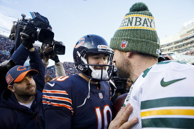 Chicago Bears quarterback Mitch Trubisky (10) greets Green Bay Packers quarterback Aaron Rodgers (12) after the Bears defeated the Packers 24-17 to clinch the NFC North title at Soldier Field on Sunday, Dec. 16, 2018.