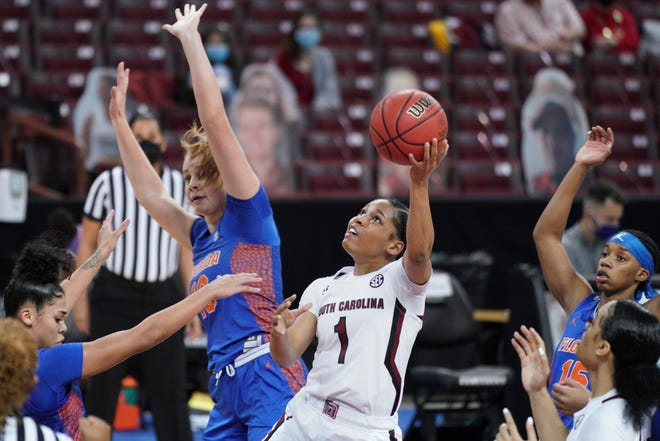 South Carolina guard Zia Cooke (1) attempts to shoot against Florida forward Floor Toonders, left, during the first half Thursday in Columbia, S.C.