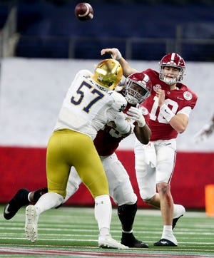 Jan 1, 2021; Arlington, TX, USA;  Notre Dame defensive lineman Jayson Ademilola (57) is blocked by Alabama offensive lineman Chris Owens (79) giving Alabama quarterback Mac Jones (10) time to throw Friday, Jan. 1, 2021 in the College Football Playoff Semifinal hosted by the Rose Bowl in AT&T Stadium. Mandatory Credit: Gary Cosby-USA TODAY Sports