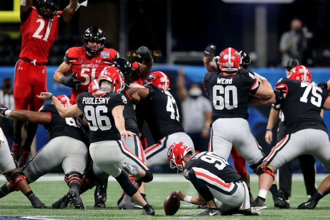 Georgia Bulldogs place kicker Jack Podlesny (96) kicks the game-winning field goal in the fourth quarter during the Chick-fil-A Peach Bowl against the Cincinnati Bearcats, Friday, Jan. 1, 2021, at Mercedes-Benz Stadium in Atlanta, Georgia. The Georgia Bulldogs won, 24-21.