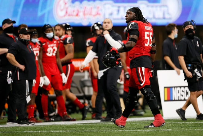 Cincinnati Bearcats offensive lineman James Hudson (55) leaves the field as he's ejected for targeting in the second quarter of the Chick-fil-a Peach Bowl at Mercedes-Benz Stadium in Atlanta on Friday, Jan. 1, 2021. The Bearcats led 14-10 at halftime.