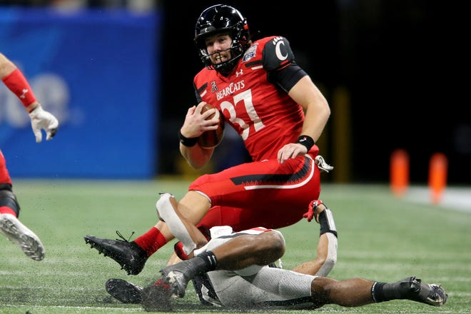 Cincinnati Bearcats punter James Smith (37) is tackled after reaching a first down on a fake punt play in the fourth quarter during the Chick-fil-A Peach Bowl against the Georgia Bulldogs, Friday, Jan. 1, 2021, at Mercedes-Benz Stadium in Atlanta, Georgia. The Georgia Bulldogs won, 24-21.