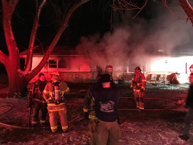 Muncie firefighters on New Year's Eve battled at a blaze at a West 31st Street home that killed at least two family pets.