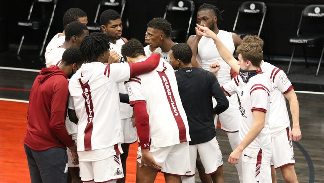 The New Mexico State men's basketball team talks things over in a huddle during its game against Benedictine Mesa on Dec. 1, 2020, in Phoenix, Arizona.