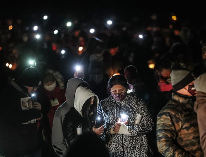 Brandy Monge and Alessandra Gutierrez of Omro were part of hundreds of people who gathered Thursday, Dec. 31, 2020, on the Omro High School track to remember Omro siblings Domynick Milis, 21, and Danycka Milis, 18, who were killed Tuesday, Dec. 29, 2020, in Daytona Beach, Florida.