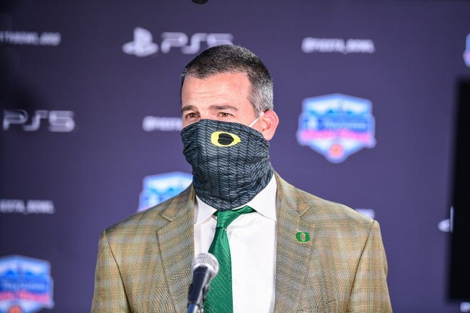 Oregon coach Mario Cristobal addresses the media upon arrival for the PlayStation Fiesta Bowl on Thursday, Dec. 31, 2020.