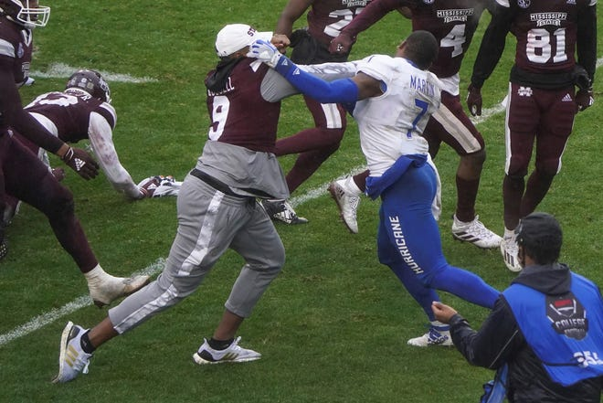 Mississippi State linebacker De'Monte Russell (9) and Tulsa safety TieNeal Martin (7) fight after time runs out in Armed Forces Bowl NCAA college football game Thursday, Dec. 31, 2020, in Fort Worth, Texas. Mississippi State won 28-26. (AP Photo/Jim Cowsert)