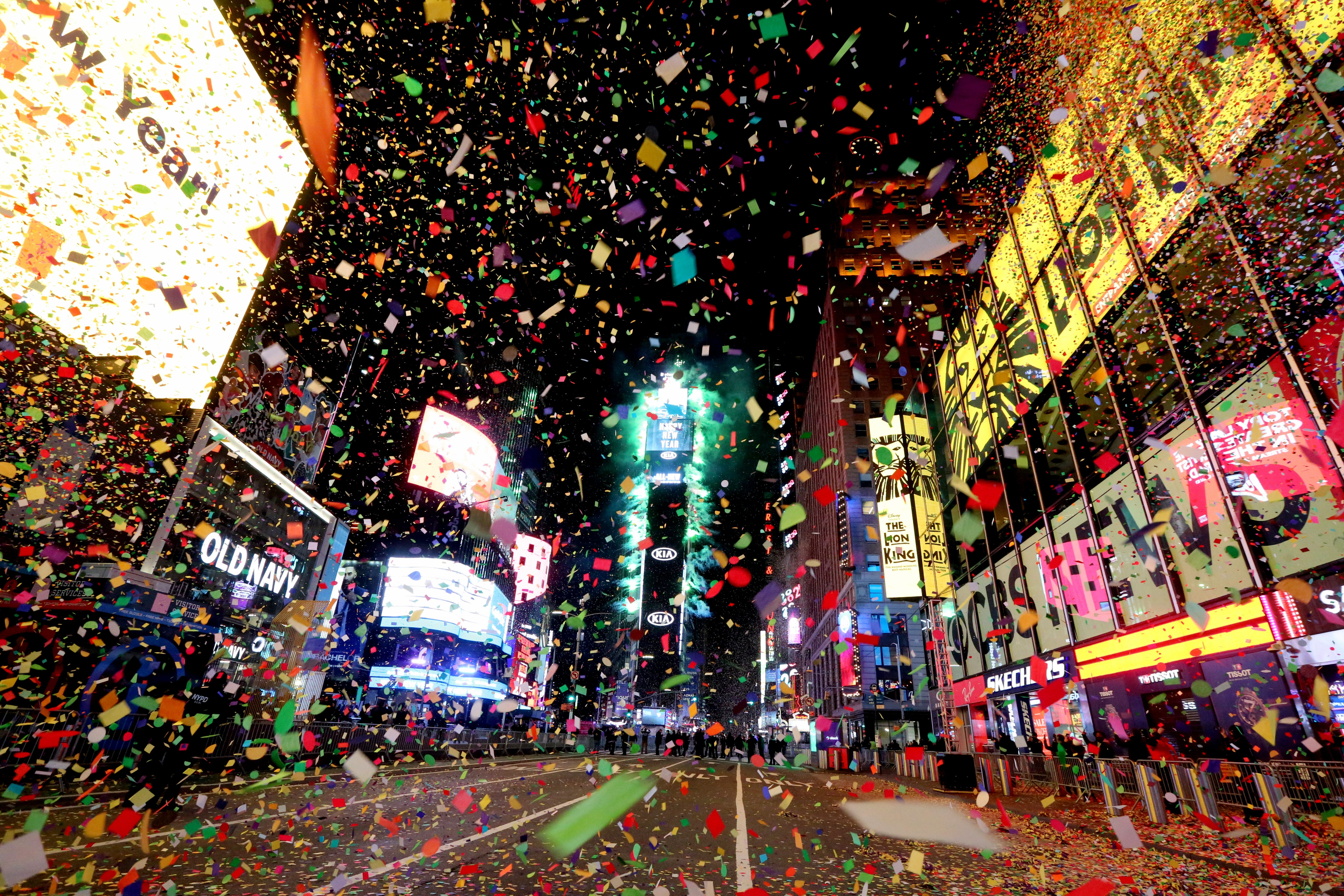 Times Square, usually packed with thousands for New Year's celebrations, was closed to all but a select few in 2020 due to COVID-19 restrictions. Here confetti rains down on the empty streets after the ball drop, marking the start of 2021.
