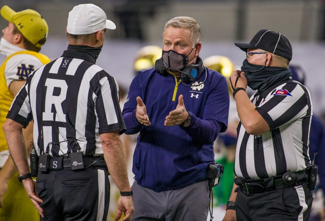 Notre Dame coach Brian Kelly complains to officials during a timeout during Friday's game vs. Alabama.