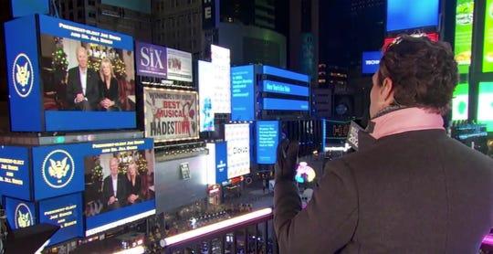Ryan Seacrest interviews Joe and Jill Biden from across Times Square.