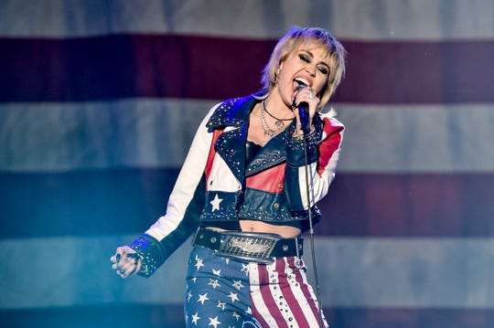 Miley Cyrus performs at Dick Clark's New Year's Rockin' Eve with Ryan Seacrest.