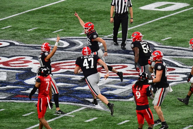 Georgia kicker Jack Podlesny (96) celebrates after kicking the game-winning 53 yard field goal against Cincinnati during the 2021 Chick-fil-A Peach Bowl at Mercedes-Benz Stadium.