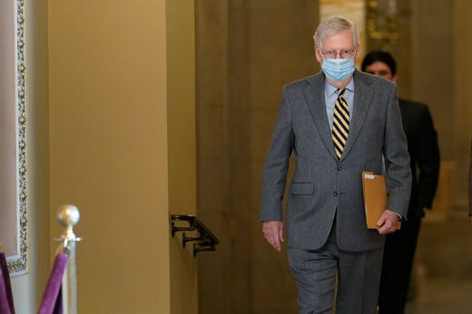 Senate Majority Leader Mitch McConnell of Ky., walks to the Senate floor on Capitol Hill in Washington, Wednesday, Dec. 30, 2020.