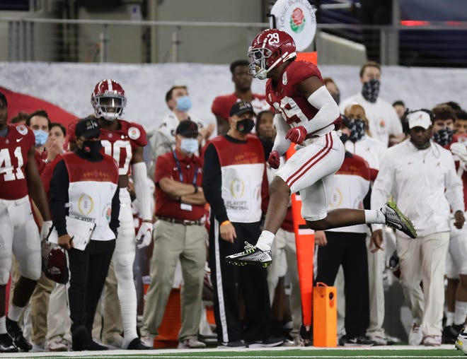 Alabama defensive back DeMarcco Hellams celebrates after Notre Dame quarterback Ian Book is tackled during the Crimson Tide's CFP semifinal win in Arlington on Jan. 1. The Tide are the betting favorites to defend their national championship.
