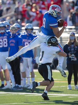 Westlake receiver Jaden Greathouse goes up for a tough catch during the Chaparrals' 34-0 win over Cibolo Steele in the Class 6A Division I Region IV final Saturday at Kelley Reeves Athletic Complex.