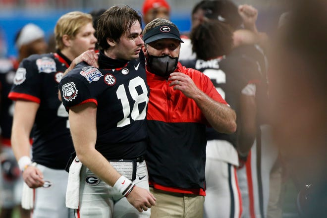 Georgia quarterback JT Daniels (18) and Georgia coach Kirby Smart speak after winning the Peach Bowl college football game between Georgia and Cincinnati at Mercedes-Benz Stadium in Atlanta., on Friday, Jan. 1, 2021. Georgia won 24-21. (Photo/Joshua L. Jones, Athens Banner-Herald)
