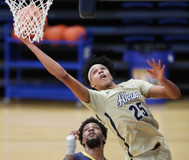 Kent State senior forward Tervell Beck defends Akron's Enrique Freeman during Friday night's game at J.A.R. Arena in Akron. Beck had missed the Golden Flashes' first four games of the season due to injury.